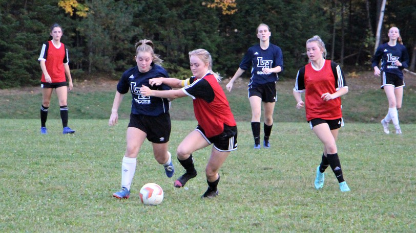 Nicole Ferguson, of the Leo Hayes Lions, challenges FHS Black Kats defender Chelsea Wilson for possession during Tuesday's 1-0 Lions' win.
