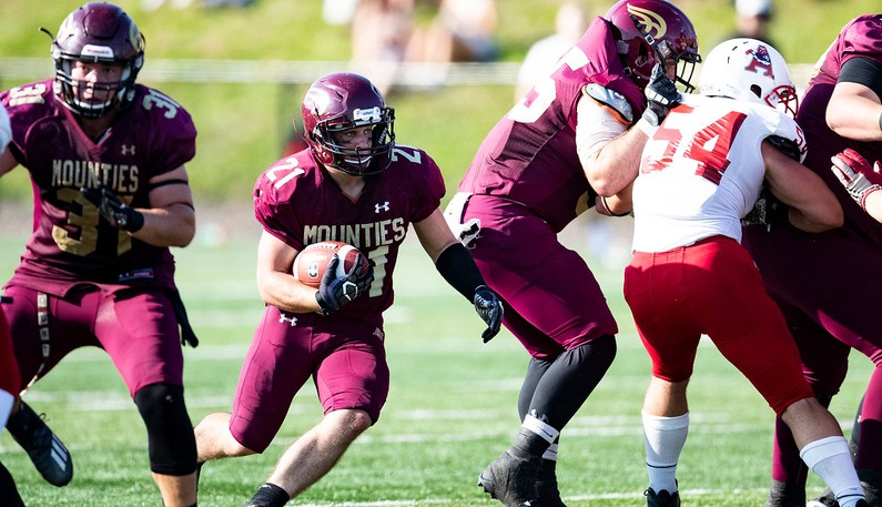 Mount Allison Mounties running back Jack Estabrooks, middle, is second in the AUS with 267 rushing yards in three games this season.