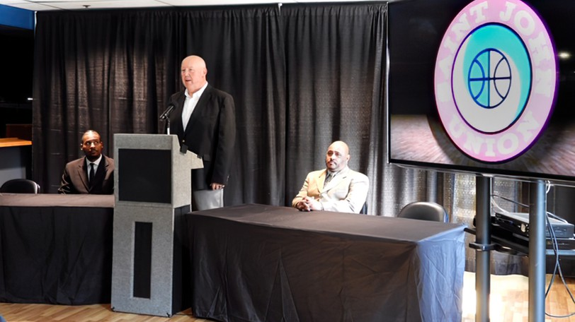 Tim Kendrick, president of the Eastern Canadian Basketball League, speaks during a press conference Wednesday at TD Station in Saint John. Also pictured are left ,Robbie Robinson, the league's senior marketing manager and Lonny States, the league's community coordinator.