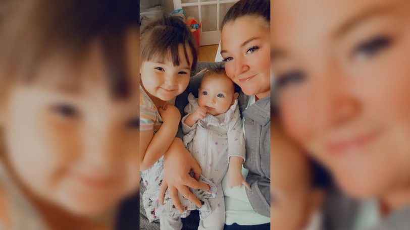 Caytlin Tribe, right, is pictured with her children Elianore Mae, 3, left, and Laurali, 5 and 1/2 months. The girls' Godparents live in Maine and the family is eager to visit when the border reopens.
