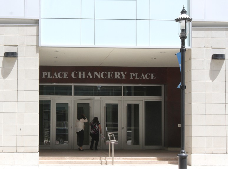 Government workers enter Chancery Place, which houses much of the province's civil service in downtown Fredericton.