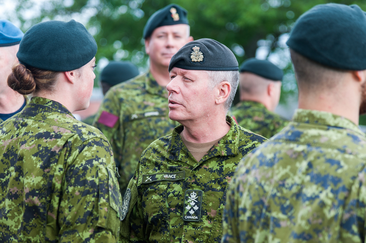 Gen. Jonathan Vance, chief of the defence staff, inspects a 50-man honour guard at the front gate of Base Gagetown in this file photo.