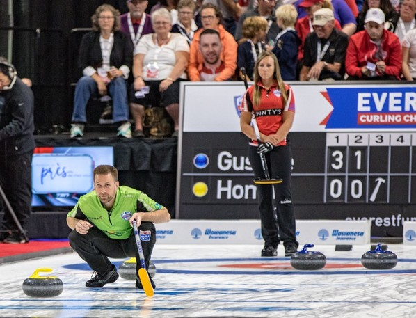 Brad Gushue and Rachel Homan watch a play develop during 2017 Everest Curling Challenge quarter-final play at Willie O'Ree Place. The skips will be returning to Fredericton in January to compete for Canada in the 2022 Continental Cup.