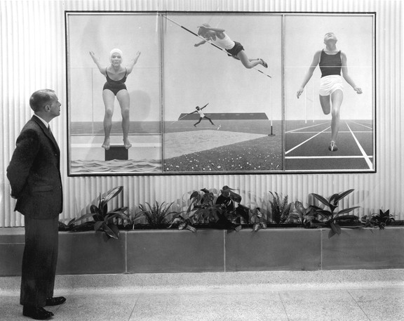 Alex Colville shown observing his mural Athletes, which was completed in 1961 for Mount Allison's new athletics buiding.