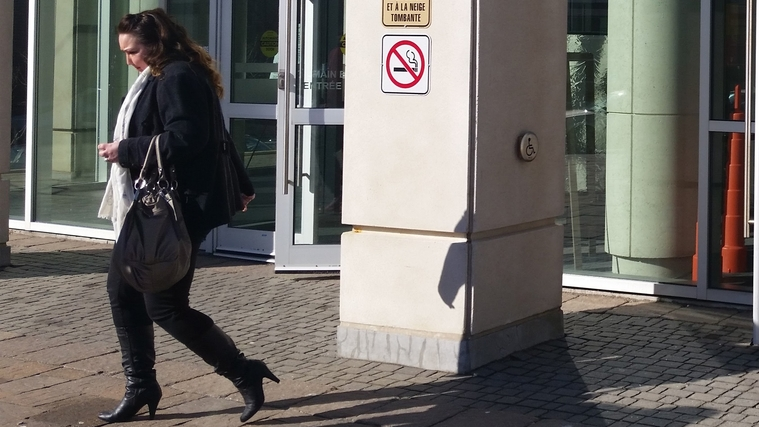 Jessica Fudge leaves the Saint John Law Courts in April 2018 after being arraigned on two counts of fraud and two of theft involving two local minor basketball leagues.