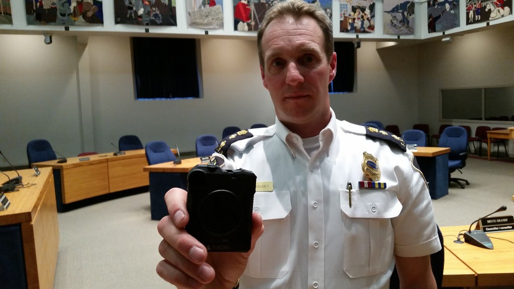 Fredericton Police Force Deputy Chief Martin Gaudet holds up a police body camera.