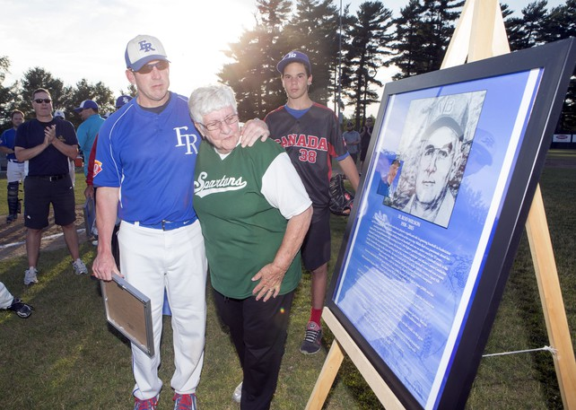 """Derek Wilson, shown in this file photo with his mother Judy in a 2015 photo in which his late father Rod Wilson Sr. was honoured by the Fredericton Royals, is working behind the scenes to resurrect the New Brunswick Senior Baseball League team in 2022. He and his mom were at the final game of the best-of-five Capital City Intermediate Baseball League final where he saw """"12 to 14 players"""" who could play senior level ball for the revitalized Royals if they were so inclined."""