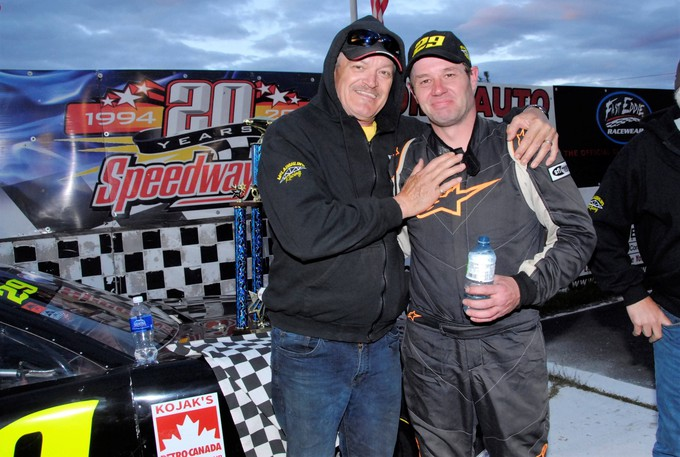 Fredericton's Rick Arbeau is shown with St. Stephen driver Greg Fahey in this 2014 victory lane file photo from Speedway 660. The fourth annual Ricky Bobby 150 street stock feature, which pays tribute to the late Arbeau, will be held Oct. 16.