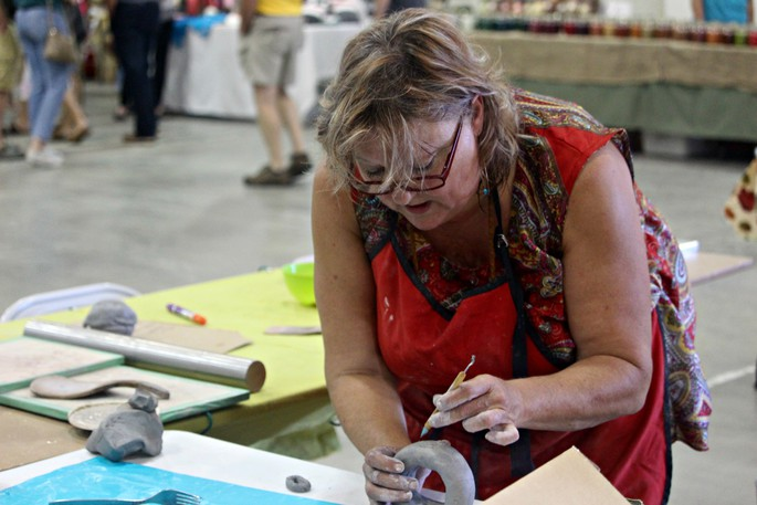 Lesley Wetmore of Log Cabin Lucy Pottery shows some tips and tricks of pottery during a demo at the Buttermilk Creek Festival craft sale in this file photo. For 2021, Buttermilk Creek is moving to the Western Valley Multiplex in Centreville.