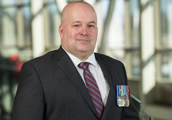 John Fife, a retired colonel in the Canadian Armed Armed Forces member who served in Afghanistan, is the new chief administrative officer for the Town of Oromocto. He stepped into his new position on Wednesday.