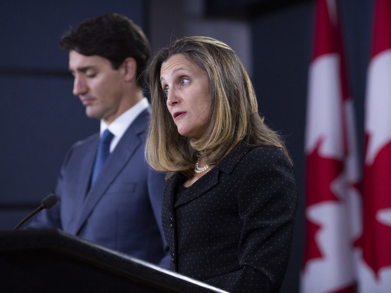 Chrystia Freeland speaks as Prime Minister Justin Trudeau listens during a news conference to discuss NAFTA agreements.