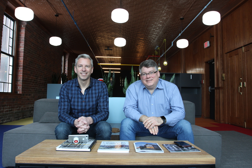 """UStation co-founders Jeff Roach and Glen Hicks are pictured here in their uptown coworking space. The Saint John businessmen now plan to bring the concept of a """"workcation"""" to the Port City."""