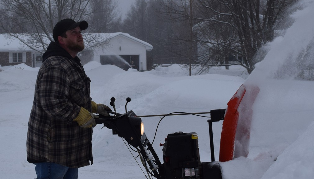 Billy DeLong snowblowed his driveway on Case Street in Fredericton in this file photo.