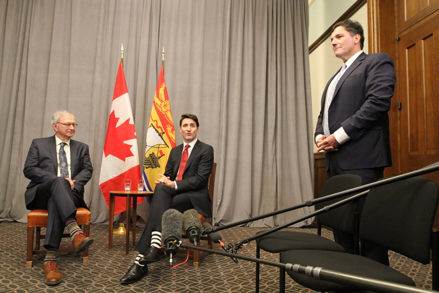 Premier Blaine Higgs is pictured with Prime Minister Justin Trudeau and New Brunswick MP and cabinet minister Dominic LeBlanc in Ottawa. The feds say they will now pay a significantly higher portion of the price tag to get infrastructure projects built quickly in New Brunswick and across the country.