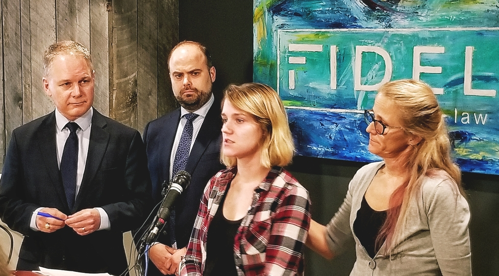 From left, lawyers John McKiggan and Mathieu Picard appear with Jayde Scott, the representative plaintiff, and Scott's mother Beverly Cuppens-Buckle at a news conference in Moncton on April 11, 2019 to announce a class action lawsuit against Horizon Health Authority and nurse Nicole Ruest over alleged inappropriate use of oxytocin during labour and delivery.