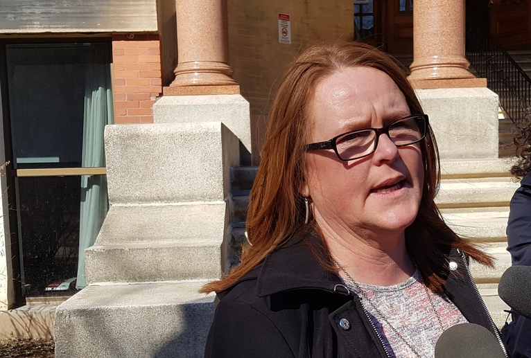Sharon Teare, president of the New Brunswick Council of Nursing Home Unions, speaks with reporters outside the Fredericton courthouse in this file photo.