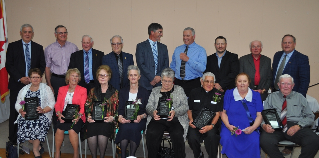 The 2019 Carleton-Victoria Outstanding Citizen Award recipients are shown in a file photo. After being cancelled for 2020 due to COVID-19, the awards are once again being handed out for 2021, by individual presentations rather than the traditional awards dinner. Previous award recipients include back row, from left, board chairman Michael Blanchard and award recipients Gerald Sullivan, Gailen Drost, Garth Hatheway, Matthew Brennan, Dirk Bishop, Joseph Gee, David Ashworth and Andrew Harvey, former Carleton-Victoria MLA. Front row, from left, are Kathryn Davenport, Margaret Drost, Phoebe Hatheway, Mildred 'Millie' Brooks, Sandra McIntosh, Father Curtis Sappier, Jo-Anne Broad and Gary Broad.