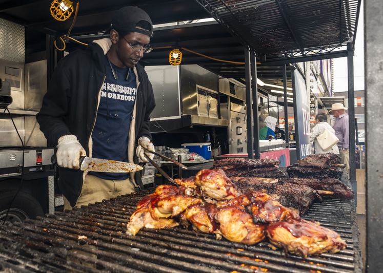 The Bathurst Rotary Ribfest is a go for Sept. 25 and 26. Abdul Dirir of Mississippi Smoke House is pictured preparing chicken and ribs during the 2019 annual Rotary Ribfest in Bathurst. Mississippi Smoke House will be one of three rib vendors this year.
