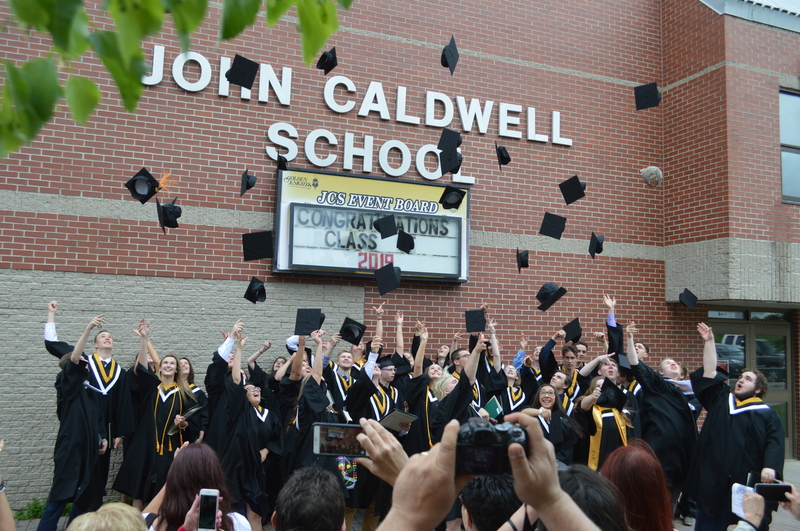 John Caldwell School class of 2019 graduates toss their caps after their graduation ceremony in a file photo. Students at the Grand Falls school will return to in-person learning on Oct. 12. They moved to distance learning more than two weeks ago due to multiple cases of COVID-19.