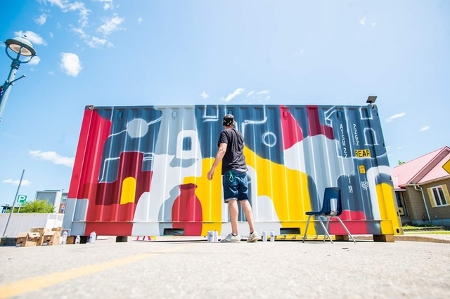 Artist Nicolas Masterson of France, who goes by the name Taro, paints a mural on a shipping container next to Dieppe City Hall during Festival Inspire.