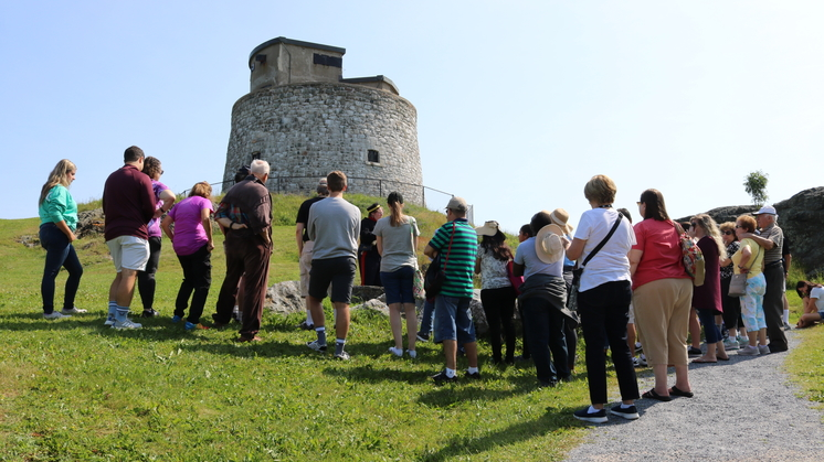 A group of tourists hears a presentation about the Carleton Martello Tower last year.