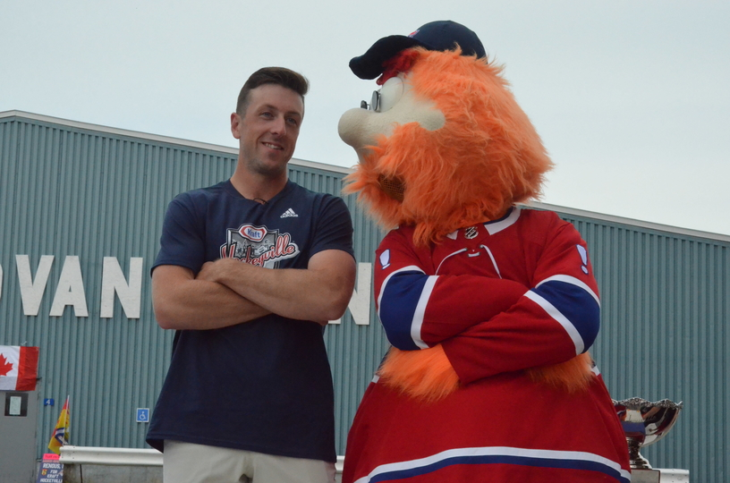 Montreal Canadiens goalie Jake Allen of Fredericton, left, shares a laugh with Youppi, the Canadiens mascot during Renous' Kraft Hockeyville celebration outside Tom Donovan Arena in 2019. Allen has agreed to terms on a two-year contract extension with the Canadiens.