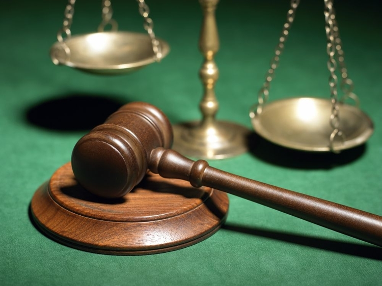 A file photo of gavel and scales.
