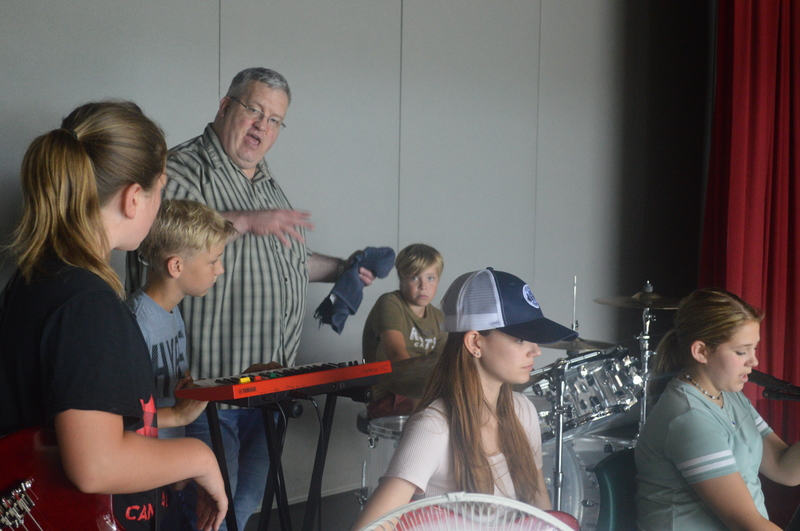 The Larlee Creek Hullabaloo Rock and Roll Boot Camp for aspiring young musicians is coming back in August. The camp wasn't held in 2020 due to the pandemic but will be open to 15 young artists this year. Terry Whalen, working with band participants in this 2019 file photo, will instruct the camp along with musicians Kendra Gale and Dan Doiron.