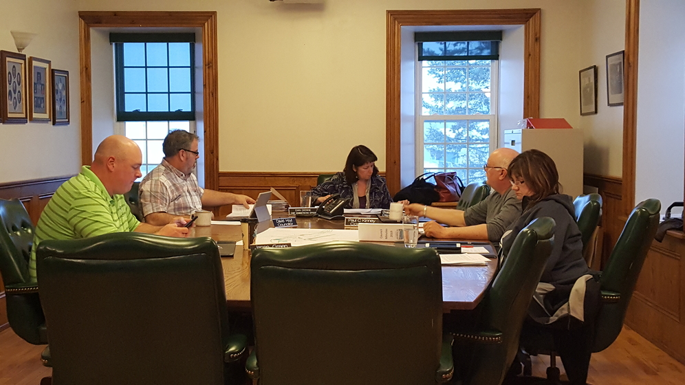 In this file photo, members of Perth-Andover village council are shown before the province's state of emergency resulted in a change to virtual meetings. With the postponed municipal elections now scheduled for May 10, the mayor and two councillors have so far indicated they'll re-offer.