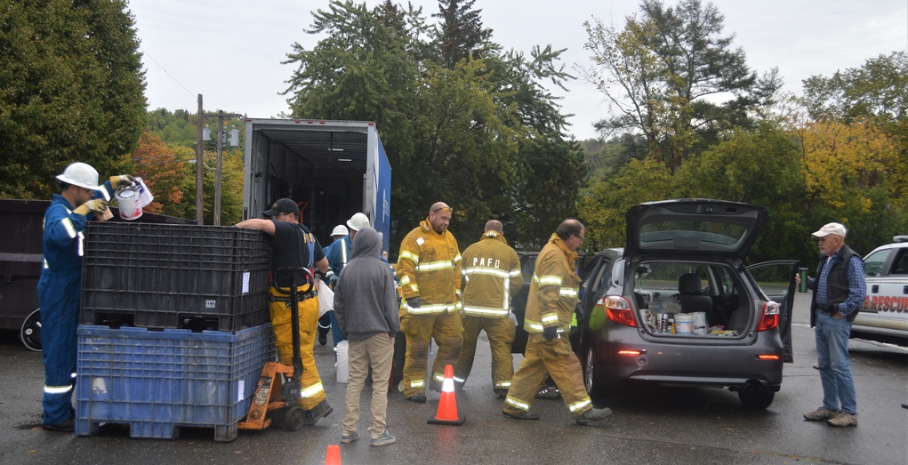 Members of the Perth-Andover Fire Department helped out with a household hazardous waste disposal day held at the River Valley Civic Centre parking lot in this file photo. A drive-thru event will be held Saturday.
