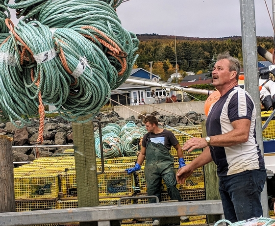 Alma lobster fisherman Martin Collins prepares to move large bundles of rope as it is loaded onto the Brittany & Madison III at the Alma Wharf in this file photo.