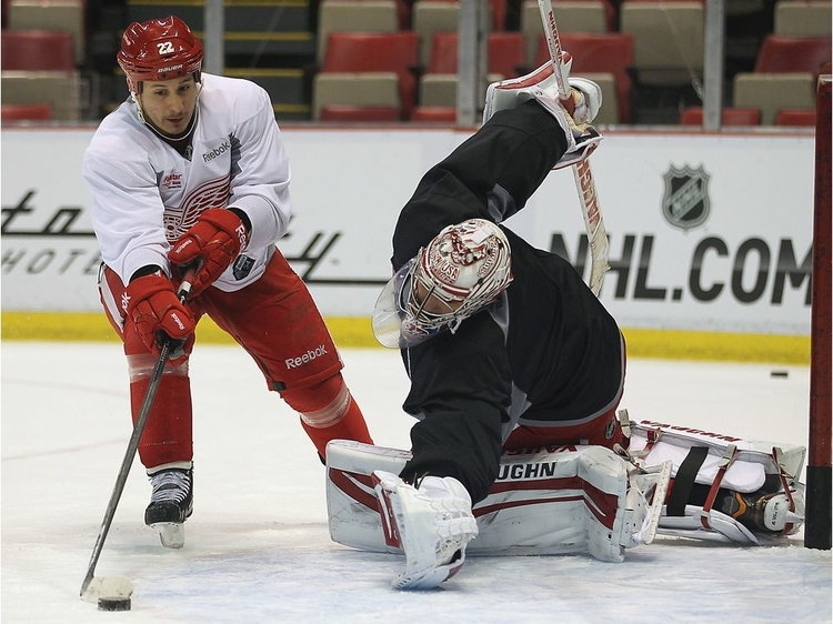 Former Detroit Red Wing forward Jordin Tootoo dekes goalie Petr Mrazek during practice in this file photo. Tootoo, who played 13 National Hockey League seasons, will be keynote speaker on March 15, 2022, as part of Kingsclear First Nation's healing week.