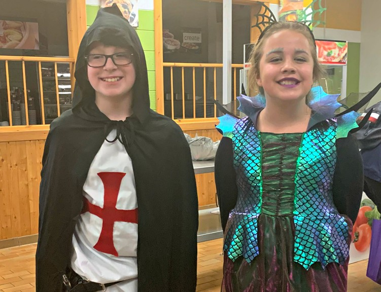 Zachary Chase and Abigail Wright teamed up and dressed as a knight and a dragon for Halloween in this file photo. Hartland Recreation is gearing up for their Haunted Courtyard event on Oct. 31.
