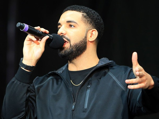 Singer Drake greets the audience in Toronto, Ont.