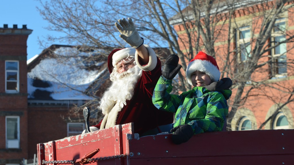 Santa and a helper wave to the crowds in downtown Woodstock during the town's Santa Claus Parade in a file photo. The Greater Woodstock Chamber of Commerce has suggested a 'social distance Santa' participate in this year's parade.