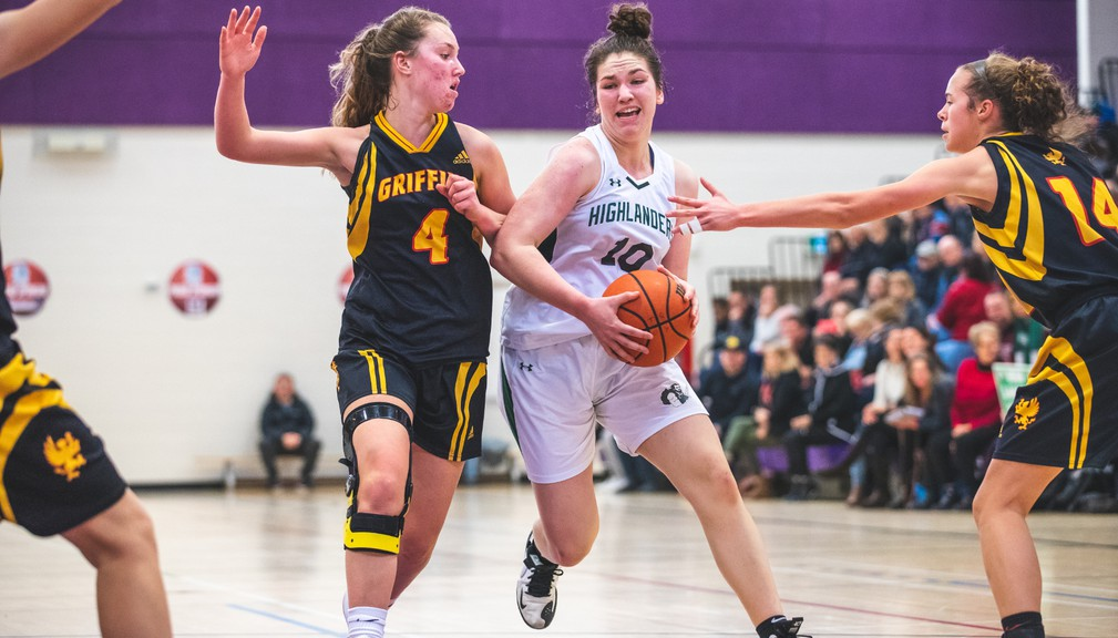 Bernice MacNaughton Highlanders' Maddie Maillet, middle, dribbles past Horton Griffins defenders in the DNA Swag Greater Moncton Ladies Hoop Classic championship game last year. This year's tournament has been cancelled because of the COVID-19 pandemic.