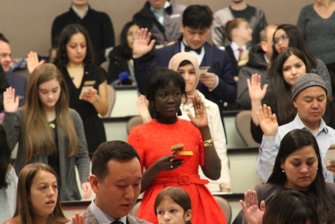 New Canadians participate in a a citizenship ceremony in Fredericton.