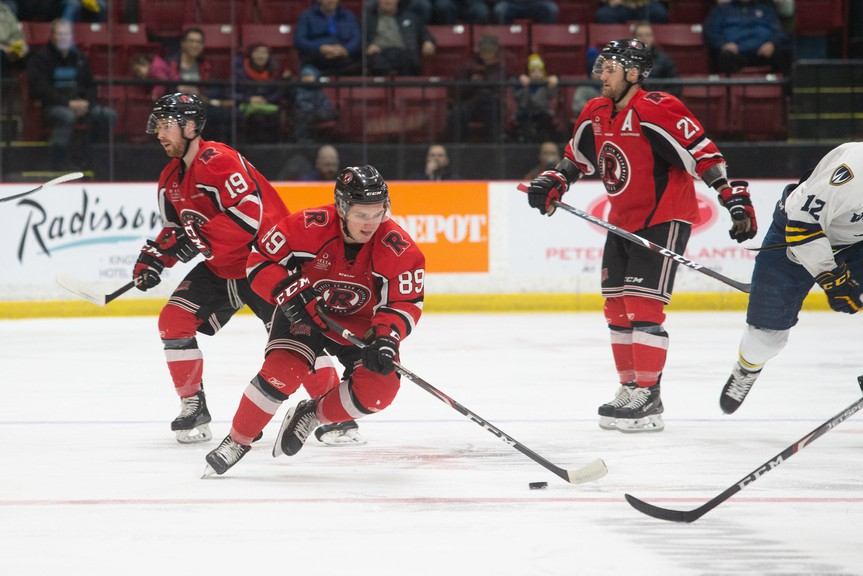 Matthew Boucher, shown in action with the UNB Reds, had a three-point weekend for the Utah Grizzlies of the ECHL.