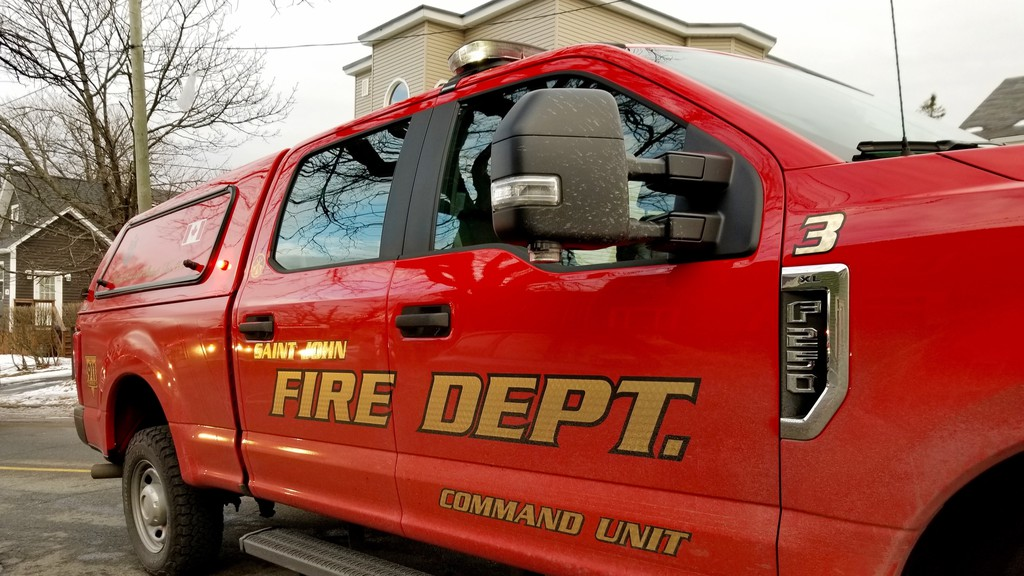 A Saint John Police and fire responded to a fire call early Tuesday morning and found a cube van on fire in a parking lot on Germain Street.