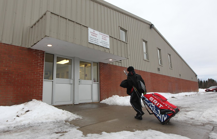 A hockey player enters the Charles Gorman Arena.