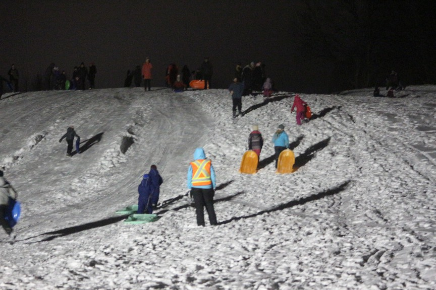 The Woodstock Recreation Department hosts a sliding party on the hills of the Woodstock Golf and Curling Club in this file photo. The department is encouraging people to get out and enjoy winter activities this season.