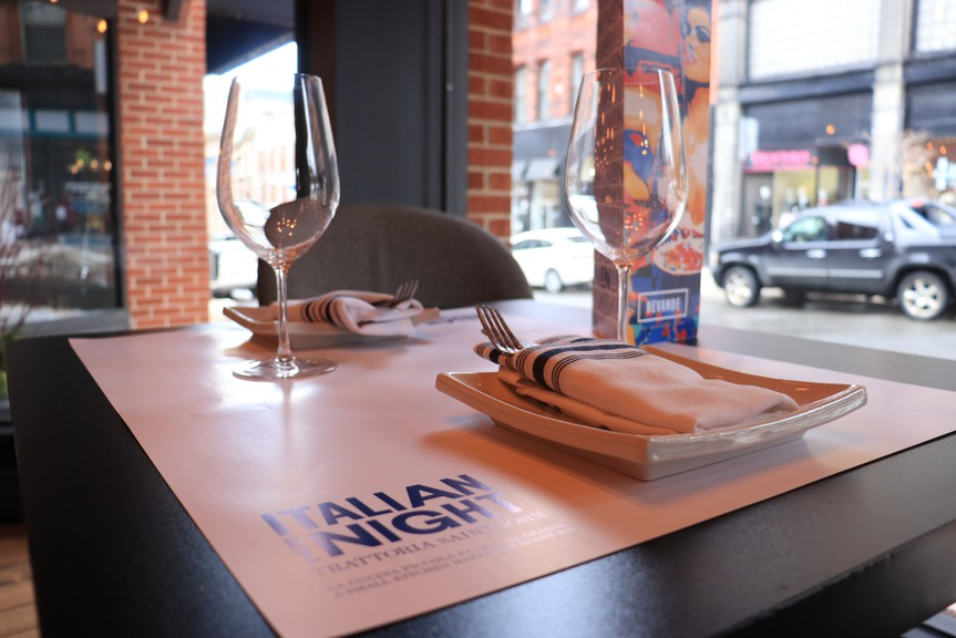 Wine glasses are set out at Italian by Night in uptown Saint John. Proposed changes to the Liquor Control Act would allow patrons to take a half-consumed bottle of wine home with them.