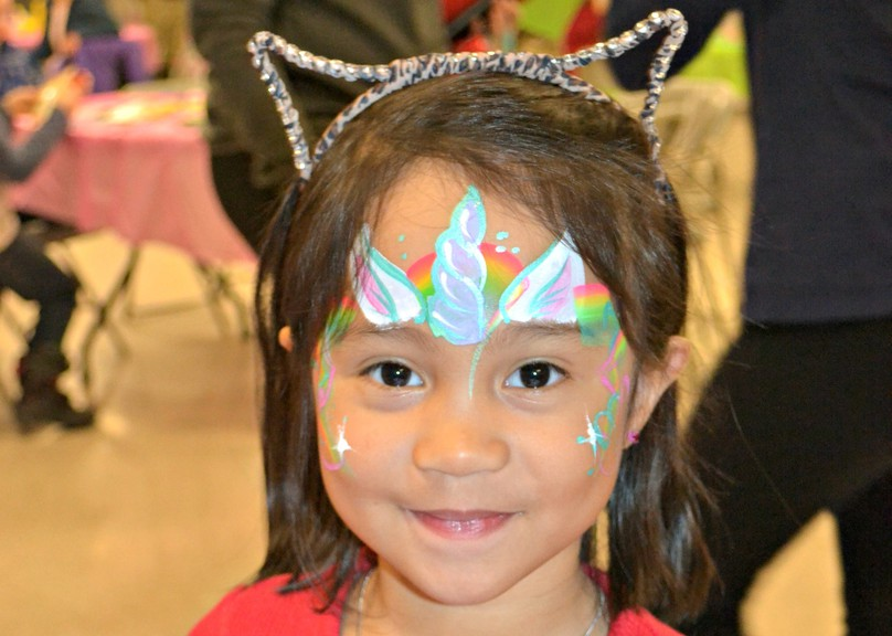 Kianne Beray poses for a photo to show off the unicorn face paint at the MACC Family Day in this file photo. MACC has put out a call for volunteers for a Halloween Scavenger Hunt.
