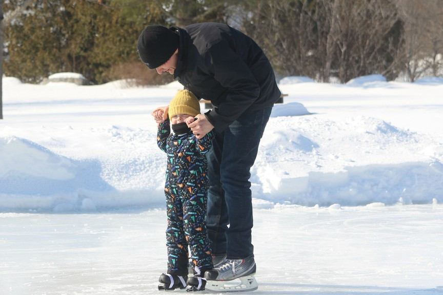 Steven Harvey shows Wren, 3, how to skate at the outdoor rink in Florenceville-Bristol in this file photo. Woodstock's director of recreation and community services shared the vision of a new outdoor rink facility using Woodstock's old ice refrigeration plant that will soon be removed from the Ayr Motor Centre at a council-in-committee meeting Monday night.