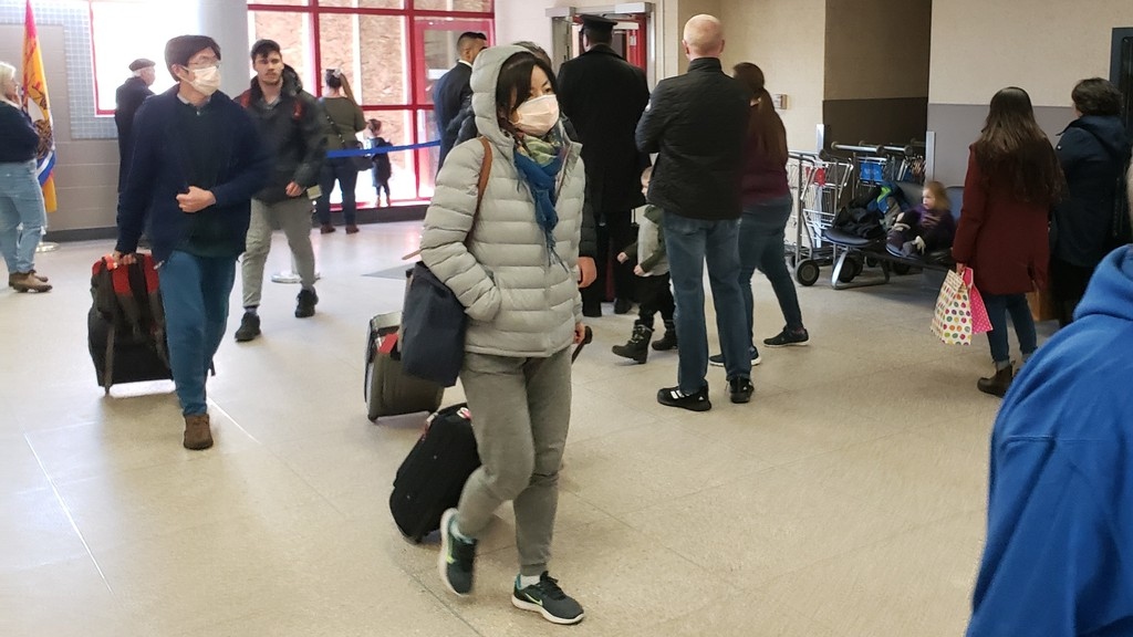 Passengers arrive from Toronto at the Fredericton International Airport.