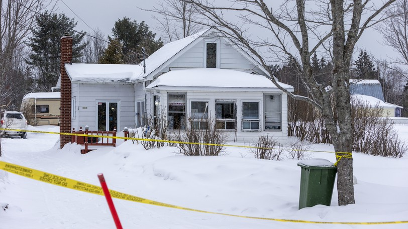 Investigators at the scene of a suspected homicide on March 10, 2020, in Saint-Ignace.