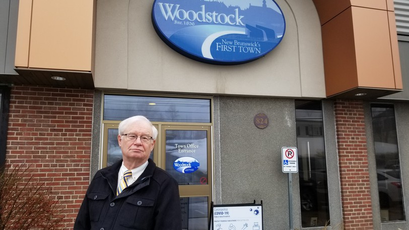 Mayor Art Slipp stands outside Woodstock Town Hall in this file photo. Council is eager to return to the town hall for meetings, but more work needs to be done first, they say.
