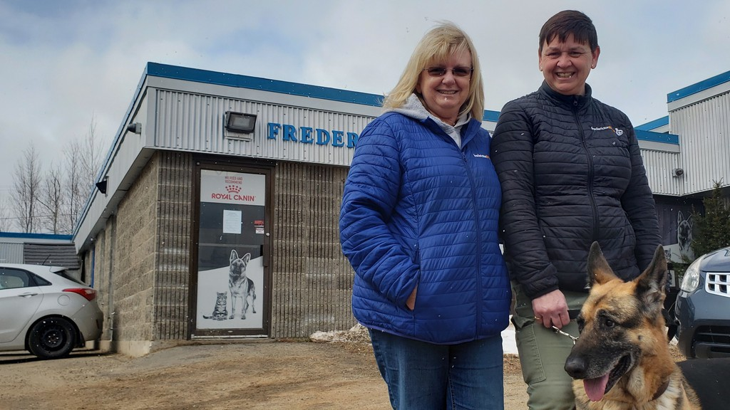 Karen McGeean, left, director of marketing and development for the Fredericton SPCA; Lynn Walker, lead supervisor, and Ace the German Shepard, are shown in this file photo.