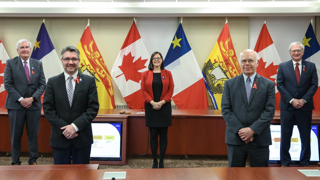 From left, Liberal Leader Kevin Vickers, People's Alliance Leader Kris Austin, Chief Medical Officer of Health Dr. Jennifer Russell, Green party Leader David Coon, and Premier Blaine Higgs before a press conference in Fredericton.
