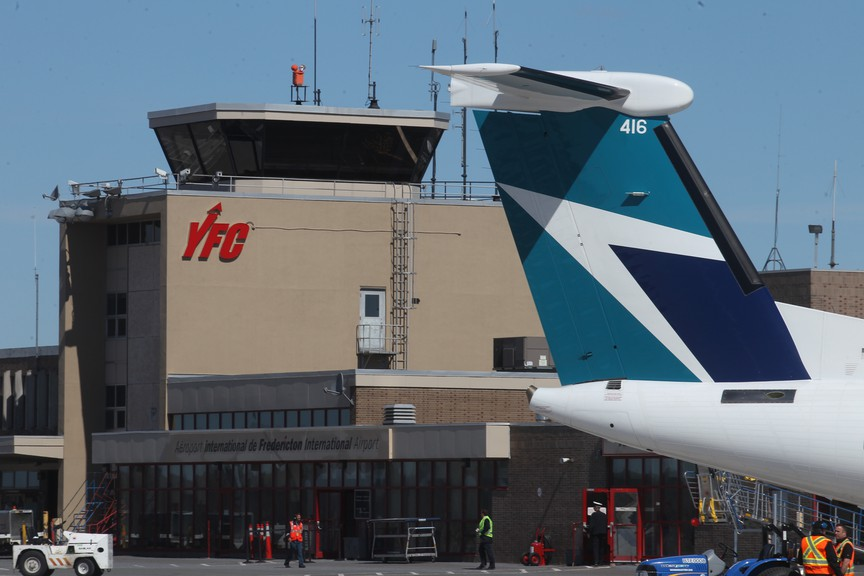 The tail of a WestJet aircraft is seen in front of the Fredericton International Airport terminal in this file photo.